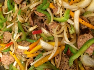 sausage with bell peppers and onions, confit